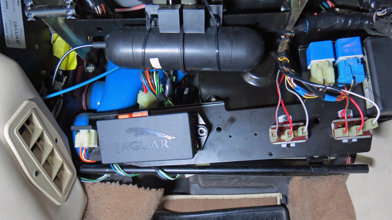 The blower motor assembly is buried behind several relays, two large brackets, the vacuum reservoir, and part of a wiring harness.  Everything has to be moved out of the way.