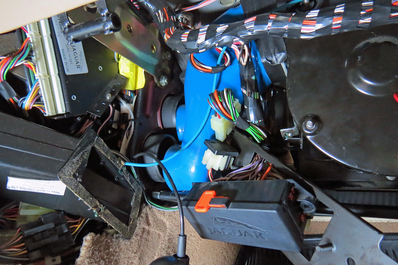 The blue hose assembly seen in the photo above connects the blower motor housing to the air handler in the center of the dash.