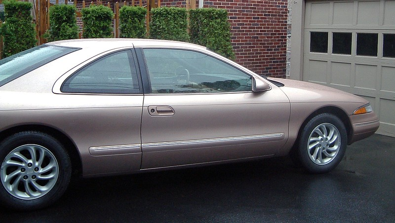 1996 Lincoln Mark VIII, 61k original miles.  I paid $5,500 for it, which I thought was a wonderful deal.