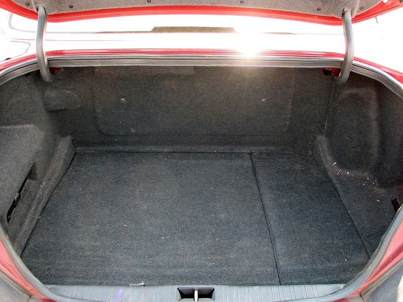 The fuel tank in the old car was positioned directly behind the rear seat backrest, making for an odd layout.  The trunk seemed larger than it actually was.