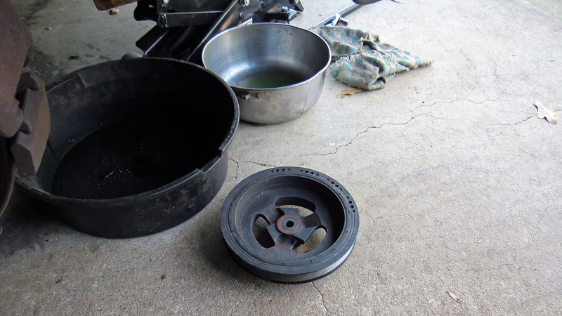 I removed the crankshaft pulley vial a combination of lowering the engine and using the special tool.