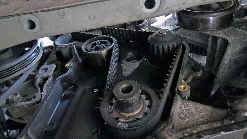 I'll remove the timing belt next by rotating the tensioner.  And since I'm replacing the water pump, I'll need to remove the inner timing belt cover