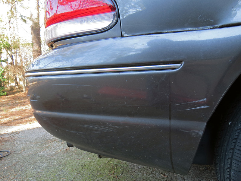 The fence post encounter left a few scratches in the bumper cover and a couple of small dents in the RR quarter panel.