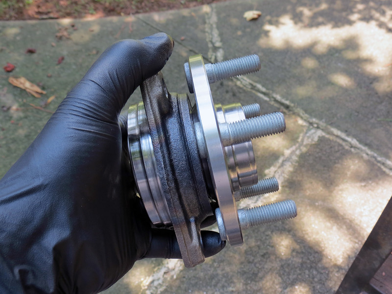 The hub bearing assembly bolts to the steering knuckle in three places and can be removed without much drama, at least in this part of the country where we don't use chemicals on the roads in the winter.