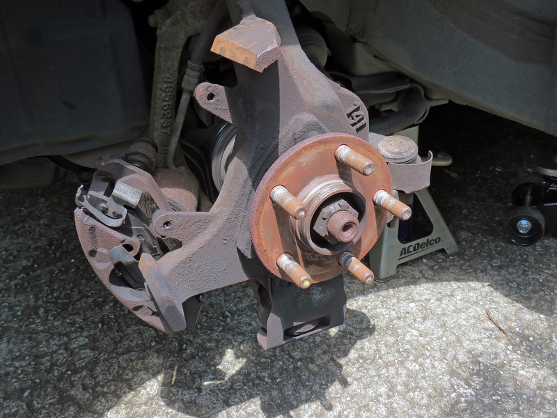 After lifting the car in the air and removing the LF wheel, I removed the brake rotor and moved the caliper out of the way.