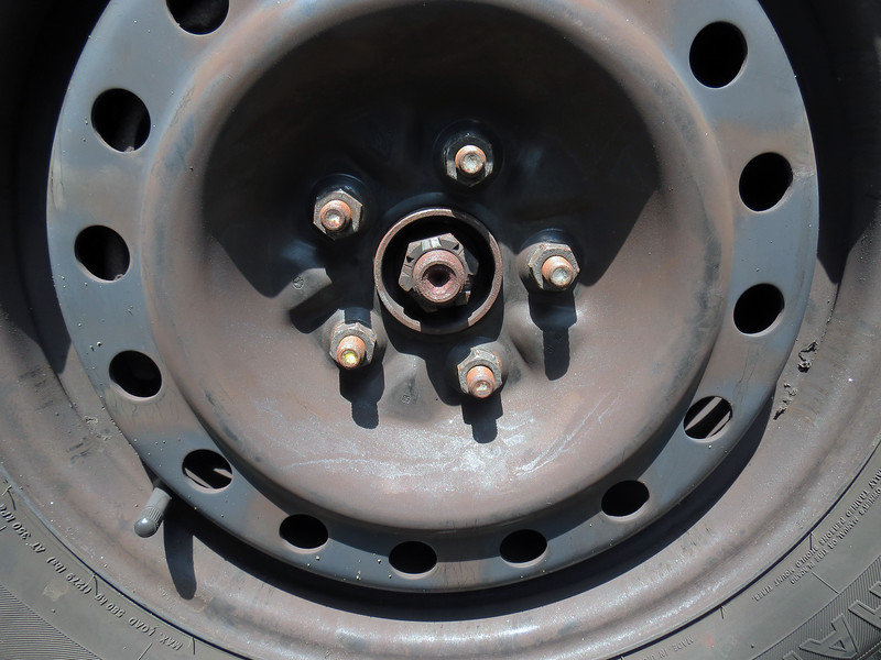 The axle nut holds the front axle to the wheel hub, and can be seen in the photo above.