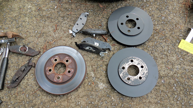 The old and new brake parts.