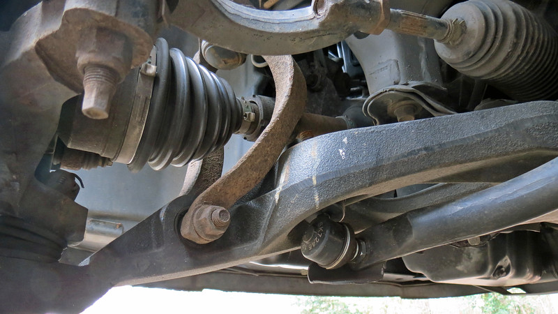 The strut is connected to the lower control arm by a long bolt which will also have to be removed.
