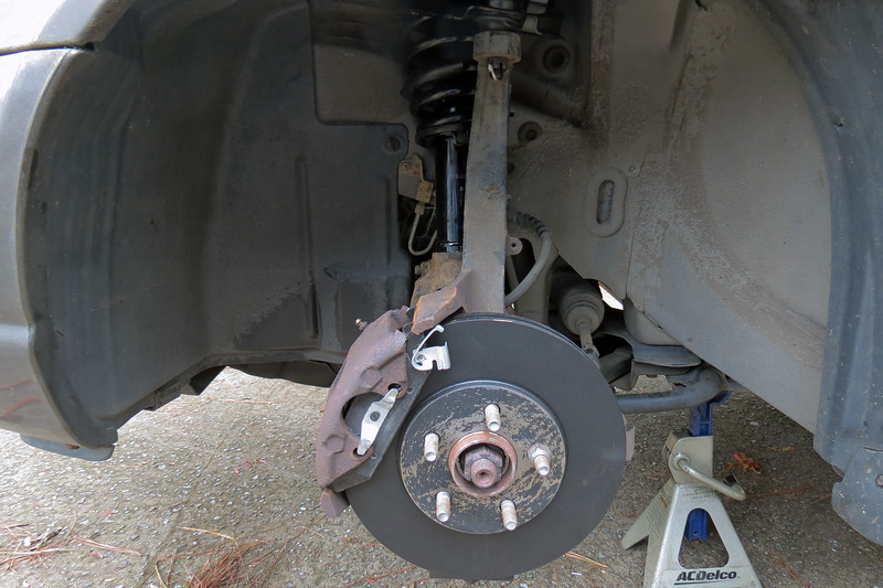 Once the new pads are installed, the caliper can be bolted back into place.  I repeated the entire process for the right front strut and brakes.  After all the repairs were complete, I took the car for a road test to make sure everything was quiet, which it was.