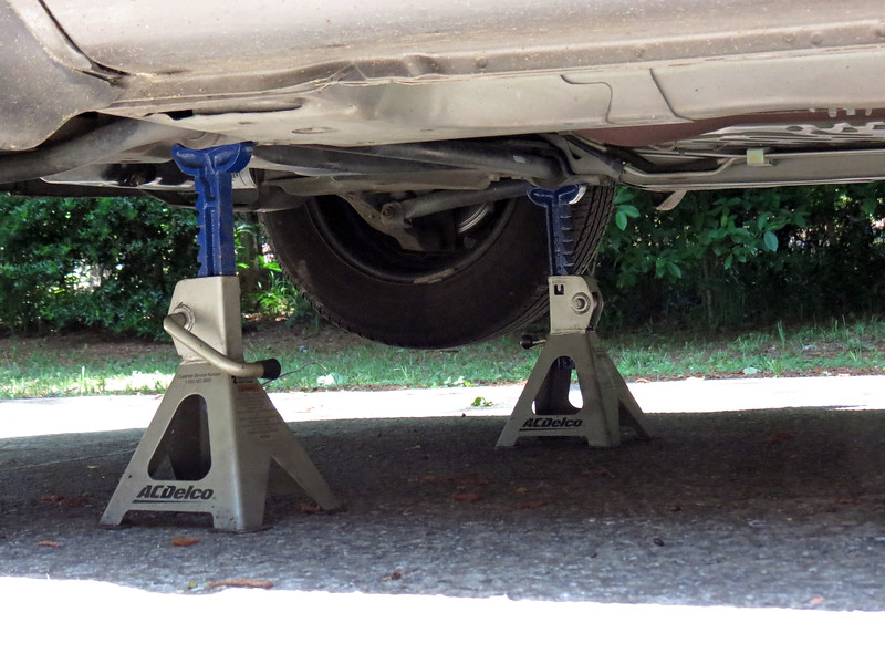 Since I don't have a vehicle lift at home, I have to use jack stands.  Always support the vehicle on a solid part of the chassis, in this case, the front sway bar brackets.
