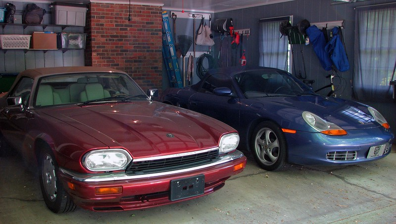 April 8, 2012:  In place of the Seafrost Metallic 2004 Jaguar XJ8 now sits a Zenith Blue Metallic 2000 Porsche Boxster.  Personally, I think it's a wonderful change of pace.  It looks great against the garage walls and its Carnival Red 1996 Jaguar XJS roommate.
