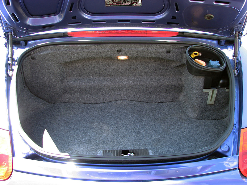 In the rear of the car, the Boxster incorporates a small-ish trunk that is large enough to hold a small suitcase or overnight bag, but not much else.