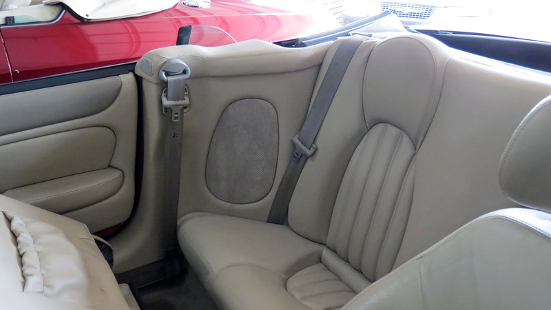 Getting to the regulator meant I once again had to tear into the interior of the car.  The first step was to remove the rear seats and RR quarter trim.  The seat cushion is removed first, followed by the backrest.  After unbolting the seat belt guide, the quarter trim can be removed.