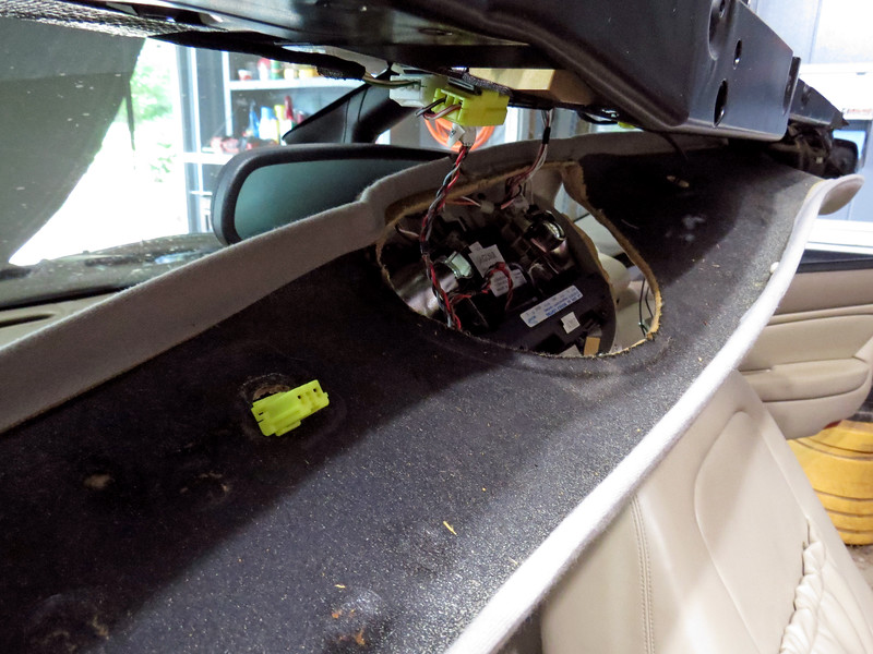 The overhead console unclips from the windshield frame and allows the interior trim panel to be removed.