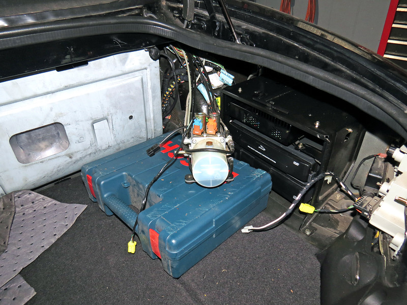 July 6:  With the lines exposed in the passenger compartment, I could now unbolt the convertible top pump motor in the trunk and slide it inboard so I could get to all of the lines.