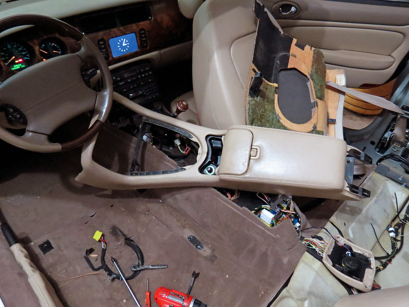 Remove the center console:  Four bolts hold the center console assembly in place.