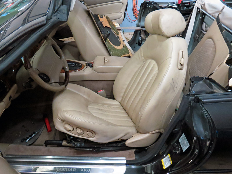 Remove the driver's seat:  It bolts to the floor in 4 places.  Slide the seat all the way forward to remove the rearward fasteners, then slide the seat rearward to remove the front fasteners.