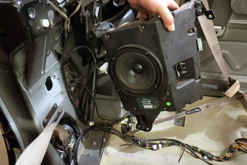Remove the right rear speaker assembly:  It unbolts in two spots.