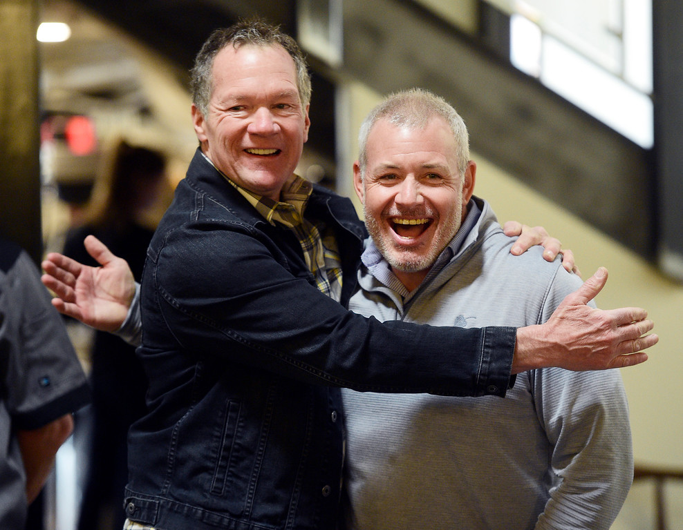 . BOULDER, CO - April 16, 2019: Owner/founder, Pat McGaughran, left and CEO, Jason Barrett,, hug before speaking to the media. The Rio Grande Mexican Restaurant recently completed its three month renovation project and opened for business last week at the Walnut and 11th Street location in Boulder. It has had a 33-year presence in Boulder. (Photo by Cliff Grassmick/Staff Photographer)