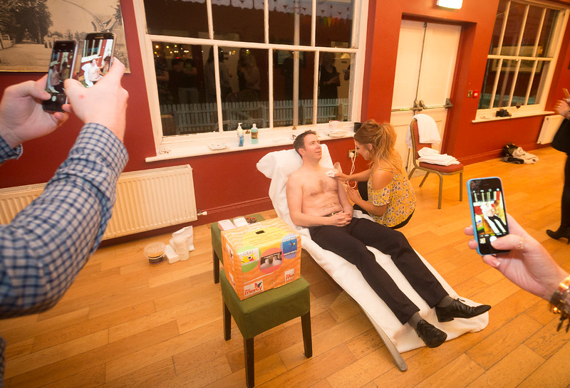 EEJob Maurice Gubbins SOCIAL 23/03/2018  Charity Fundraising Event for The Mercy Hospital Foundation by The River Lee Hotel and its staff.  Pictured Ruairí O'Connor General Manager of The River Lee Hotel as he is waxed by Nicola Murphy at the Cork Cricket Club Cork City. Staff at the Hotel eagerly capturing the event on their camera phones.   Picture: Andy Jay
