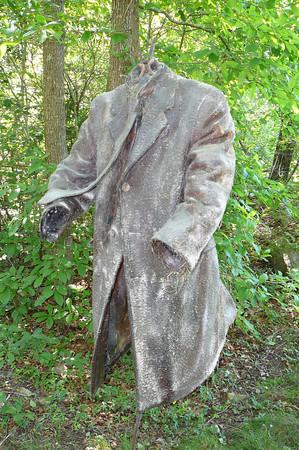 """""""Green Men"""" (polyester, resin, dirt, grass & mixed media, 2009) by Ellen Lewis Watson"""