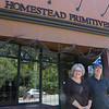 You can see a car speeding by the Homestead Primitives shop on River Street in Fitchburg with owners Charleen Boisvert and Roger Boisvert out front. SENTINEL & ENTERPRISE/JOHN LOVE