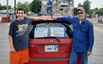 Tim Griffith and the signs he and his family made to flag us down in Kings Mountain, North Carolina on May 22, 2021