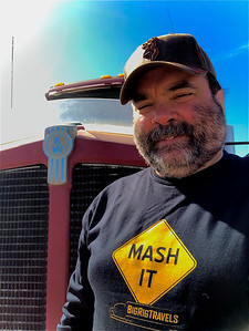TBear (Tony) from Tracy, California is wearing his fancy Mash It Shirt from BigRigTravels as he stands by his Kenworth Tractor