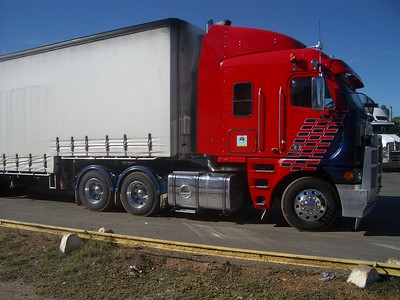 BRT viewer sends pics of his bigrig from South AustraliaArgosy 110 cab, C15 Cat, 26 metre B double  85.28 Feet long