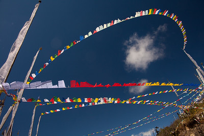 Prayer flags in Bhutan. People believe that as the wind blows, the prayers imprinted on the flags are carried into the heavens. The five different colors represent the five elements of nature: fire, water, earth, sky, and vegetation.
