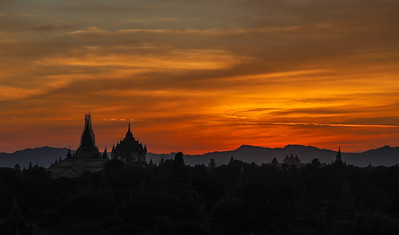 Sunset view from atop a temple in Bagan, Myanmar, looking  toward the Arakan Mountains. Between the 11th and 13th centuries, more than 4000 Buddhist temples, pagodas and monasteries were built in the Bagan plains. The remains of more than 3800 survive to this day.
