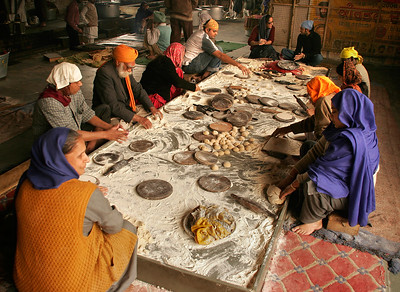 "In the basement of a Sikh temple in Delhi, India. One of the tenets of the Sikh faith is to share the fruits of one's labor with others. In keeping with this teaching, each day the temple serves some 10,000 people with free food, all prepared in the langara (kitchen) by volunteers for whom it is part of their active spiritual practice.  People of all faiths and income levels are welcome, although for the most destitute it is ""a day's peace of mind""."