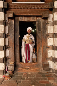 A priest welcoming us at the door of an Ethiopian Orthodox Church in Ethiopia. The kingdom of Aksum, part of present-day Ethiopia, was among the first Christian countries in the world, adopting Christianity in the 4th century AD.