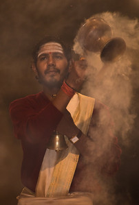 A Brahmin priest during an evening worship ceremony on the banks of the Ganges at Varnasi, India.