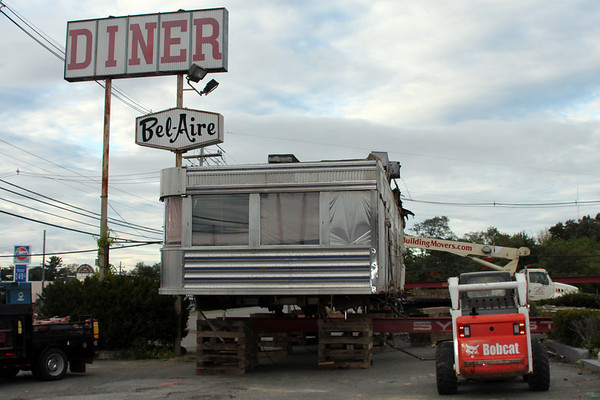 Peabody: Bel-Aire Dinner is propped up by a crane.  photo by Alan Burke / Salem News