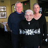 Salem:<br /> Claire Schnieder, 96, poses with her daughter, Deborah Schneider, and her son-in-law George Harrington, owner of the Lyceum Bar and Grill on Church Street. Claire is a popular lunchtime hostess at the restaurant, and is believed to be one of the oldest hostesses in the country.<br /> Photo by Amanda McGregor/Salem News.