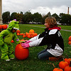 Emily Edge (9) of Salem, MA, helping Cristian Hyde-Lagasse (1 1/2), or Salem Ma, pick out a Pumpkin for the Pumpkin Decorating Contest held in the Salem Commons on Sunday October 18th. Photo by Jennifer Ballou/Salem News