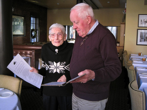 "Salem:<br /> Claire Schneider, 96, is a lunchtime hostess at Lyceum Bar and Grill on Church Street in Salem. She is pictured with fellow host Dick Thompson of Salem, who calls Schneider ""an amazing lady.""<br /> Photo by Amanda McGregor/Salem News."