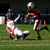 Dylan Terry advances and Saugus drops back. Beverly Panthersbeat Saugus 51-0 on Saturday, October 31, 2009.