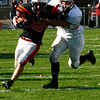 Beverly's Dylan Terry moves past Saugus in the first quarter on Saturday, October 31.