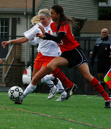 Sophomore Lady Viking Karly Henderson goes head to head with Bridgewater State's Carrie Robitaille at Alumni field on Saturday October 17th. The Bridgewater State Women's soccer team beat the Salem State Lady Vikings 3-1.  Photo by Jennifer Ballou/Salem News
