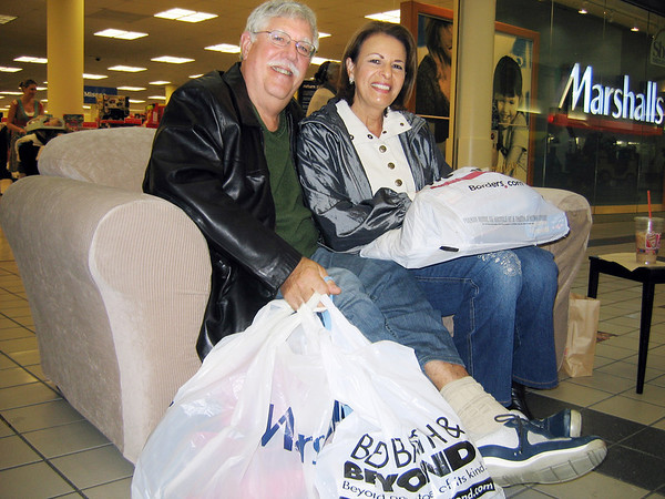 Danvers:<br /> Howard and Maxine Soep, of Ipwich speak about the items they purchased at the Liberty Tree mall on Black Friday.<br /> Photo by Cate Lecuyer/Salem News, Friday November 27, 2009.