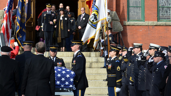 Members of the Massachusetts Army National Guard 54th Volunteer Regiment carry the casket at the funeral for U.S. Sgt. James Ayube Jr. of Salem Massachusetts, a combat medic killed last week in Afghanistan.  Lauren Ayube, James' widow, exits St. James Church in Salem accompanied by Brigadier General Tim E. Trainor.   photo by Mark Teiwes / Salem News