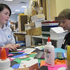 Rebecca Porter, 17, who is from Northern Ireland, works on a project with Phoenix School student Noah Kenney, 11, on Tuesday morning.<br /> Photo by Amanda McGregor/Salem News, Tuesday,  October 26, 2010.