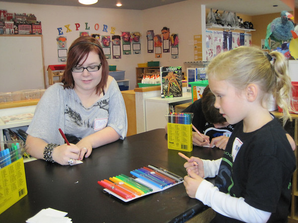 Ciara McSorley, 16, who is from Northern Ireland, works on an art project with Phoenix School students Luke Pulaski, 7, and Ella Levesque, 6.<br /> Photo by Amanda McGregor/Salem News, Tuesday,  October 26, 2010.