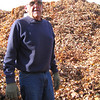 Beverly: Tom Marshall stands in front of the huge pile of leaves at the compost site in Beverly. Photo by Paul Leighton/Salem News