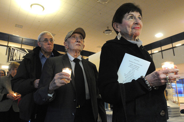 Peabody:<br /> From left, Golda Greenbaum, Mark Kres, Max Cole, a survivor of the Holocaust, and Charlotte Gross, whose husband was a survivor of the Holocaust, lead the line of people carrying candles entering the Peabody High School auditorium at the start of the Holocaust rememberance ceremony.<br /> Photo by Ken Yuszkus/The Salem News, Monday, April 8, 2013.