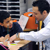 Salem:<br /> Bates Elementary School 1st grader Joshua Saldivar  receives help from his teacher Richard Giso's while working on handwriting skills.<br /> Photo by Ken Yuszkus/The Salem News, Friday, April 5, 2013.