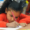 Salem:<br /> Bates Elementary School 1st grader Jocelyn Salcedo  works on her handwriting in Richard Giso's class.<br /> Photo by Ken Yuszkus/The Salem News, Friday, April 5, 2013.