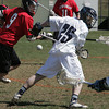 Peabody:<br /> Mablehead's Liam Gillis , left, eyes the ball that escaped from Peabody's Keifer Heckman during the Marblehead at Peabody boys lacrosse game.<br /> Photo by Ken Yuszkus/The Salem News, Thursday, April 18, 2013..